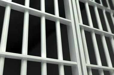 White bars of a jail cell.