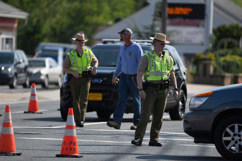 Maryland State Police divert traffic at Belair Road and Chapel Road after a Baltimore County officer was killed