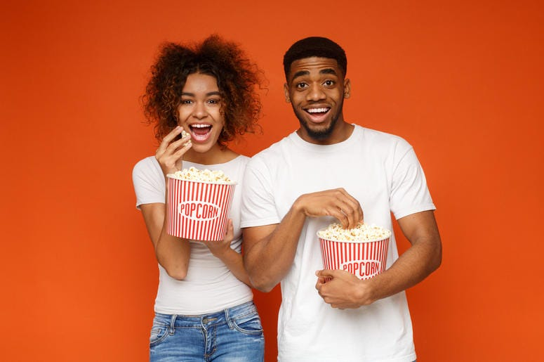 Two People Eating Popcorn