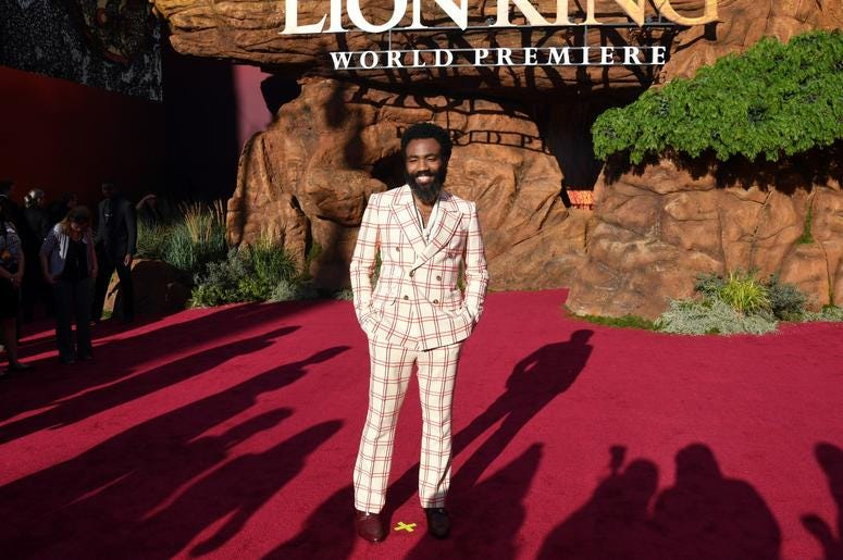 Donald Glover shows off his plaid suit at the 'Lion King' premiere.