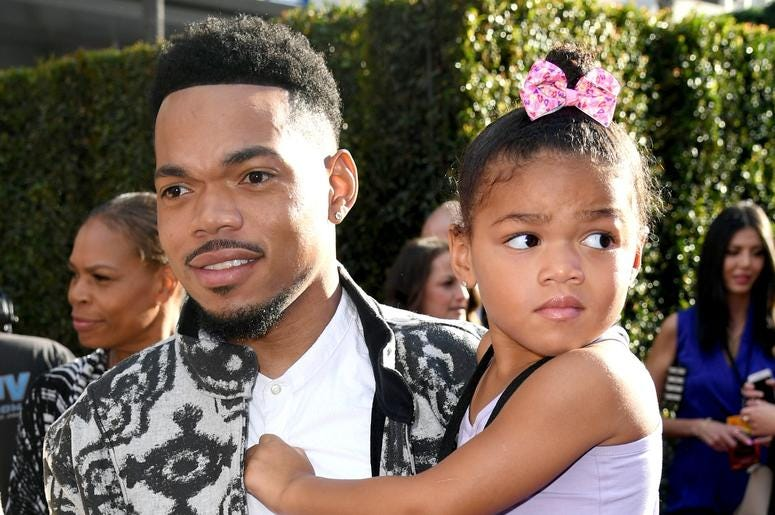 Chance The Rapper hits the red carpet with his daughter.