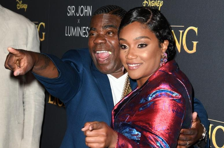 Tracy Morgan and Tiffany Haddish coordinate in suits.
