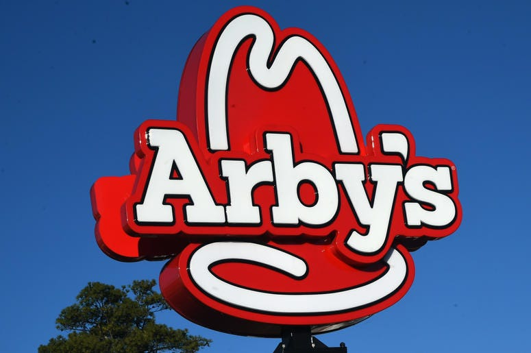 A large Arbys sign.