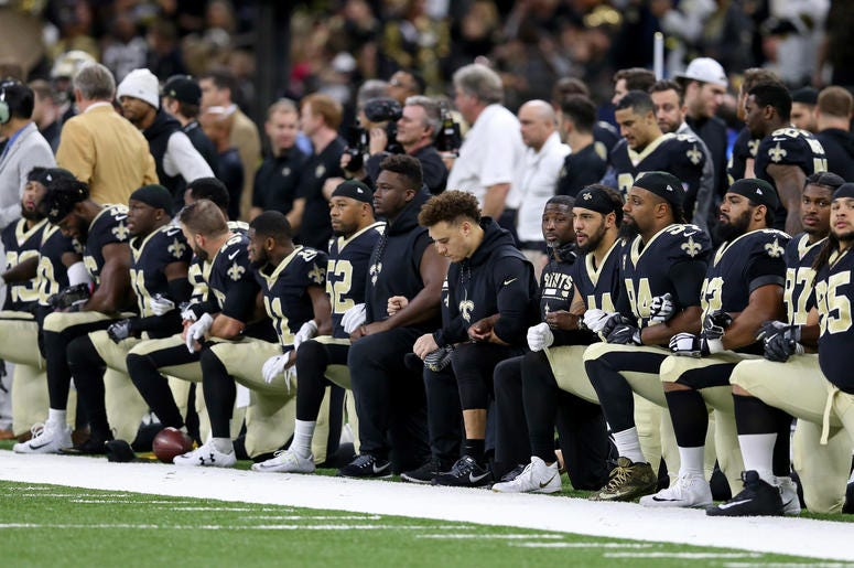 football players kneeling during national anthem nfl