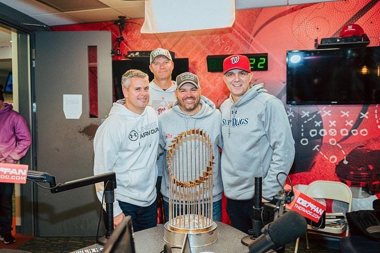The Sports Junkies pose with the trophy.