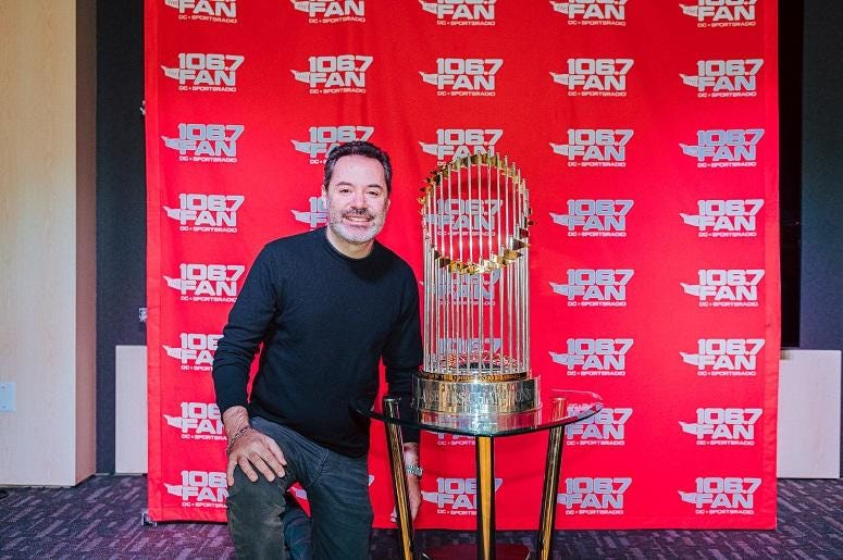94.7 The Drive's Rod Hendrix poses with the trophy.