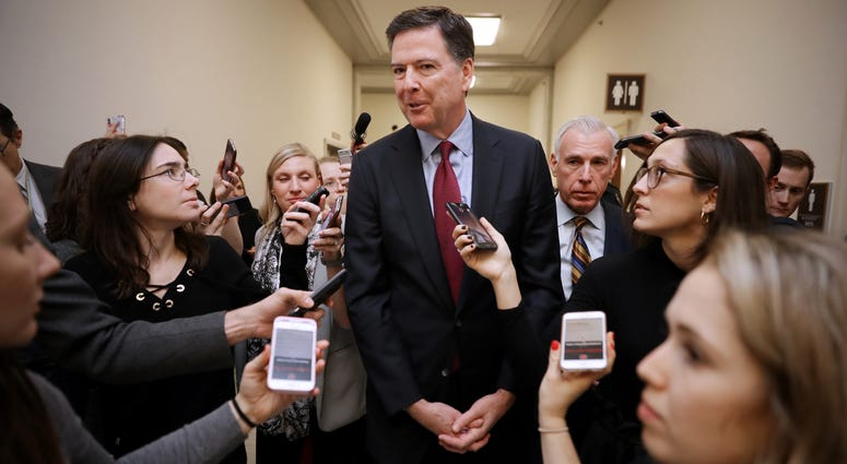 Former Federal Bureau of Investigation Director James Comey is surrounded by reporters after testifying to the House Judiciary and Oversight and Government Reform committees at the Rayburn House Office Building on Capitol Hill December 07, 2018 in Washing