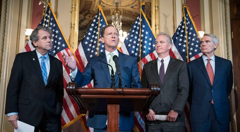 "WASHINGTON, DC - DECEMBER 18: Sen. Pat Toomey (R-PA) speaks at a press conference on S.667, the ""Otto Warmbier North Korea Nuclear Sanctions and Enforcement Act,"" with a bipartisan group of Senators and Cindy and Fred Warmbier"