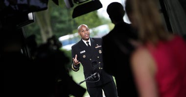 WASHINGTON, DC - JULY 07: U.S. Surgeon General Jerome Adams answers questions during a television interview July 7, 2020 in Washington, DC. Adams recently argued against a nationwide mask mandate to battle coronavirus indicating such a mandate would lead