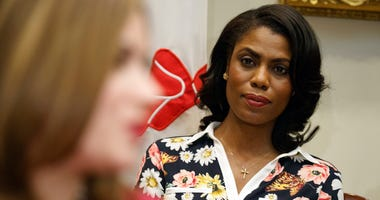 FILE - In this Feb. 14, 2017, file photo, Omarosa Manigault-Newman, then an aide to President Donald Trump, watches during a meeting with parents and teachers in the Roosevelt Room of the White House in Washington. The White House is slamming a new book b