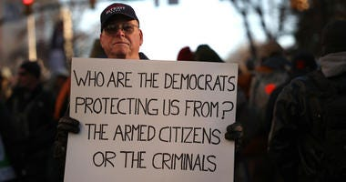 RICHMOND, VIRGINIA - JANUARY 20: Gun rights advocates attend a rally organized by The Virginia Citizens Defense League on Capitol Square near the state capitol building January 20, 2020 in Richmond, Virginia. During elections last year, Virginia Governor