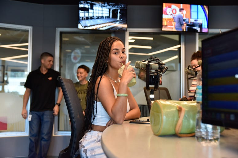Jorja Smith enjoys an iced latte from Vice City at The Citadel in Miami