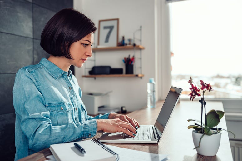 Woman using laptop in the office