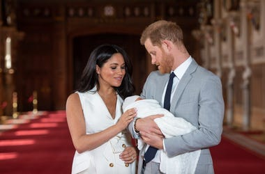 WINDSOR, ENGLAND - MAY 08: Prince Harry, Duke of Sussex and Meghan, Duchess of Sussex, pose with their newborn son Prince Archie Harrison Mountbatten-Windsor during a photocall in St George's Hall at Windsor Castle on May 8, 2019 in Windsor, England. The