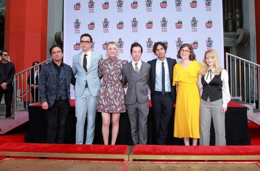 """HOLLYWOOD, CALIFORNIA - MAY 01: (L-R) Johnny Galecki, Jim Parsons, Kaley Cuoco, Simon Helberg, Kunal Nayyar, Mayim Bialik and Melissa Rauch from the cast of """"The Big Bang Theory"""" attend their handprint ceremony at the TCL Chinese Theatre IMAX on May 1, 20"""