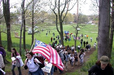 KENT, OH - MAY 4: Kent State University (KSU) students, alumni and friends chant anti-war slogans and cry for peace while marching through campus to the site where fellow students were killed while protesting the Vietnam War 34 years ago May 4, 2004 in Ke