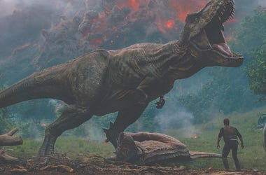 """Owen (CHRIS PRATT) meets the vicious T. rex in """"Jurassic World: Fallen Kingdom."""" When the island's dormant volcano begins roaring to life, Owen and Claire (BRYCE DALLAS HOWARD) mount a campaign to rescue the remaining dinosaurs from this extinction-level"""
