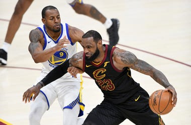 Jan 15, 2018; Cleveland, OH, USA; Cleveland Cavaliers forward LeBron James (23) drives against Golden State Warriors forward Andre Iguodala (9) in the third quarter at Quicken Loans Arena. Mandatory Credit: David Richard-USA TODAY Sports