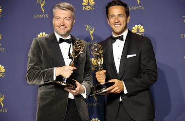 """From left, Charlie Brooker and William Bridges pose with their awards for Writing for a Limited Series, Movie or Dramatic Special for \""""Black Mirror\"""" in the photo room during the 70th Emmy Awards at the Microsoft Theater"""