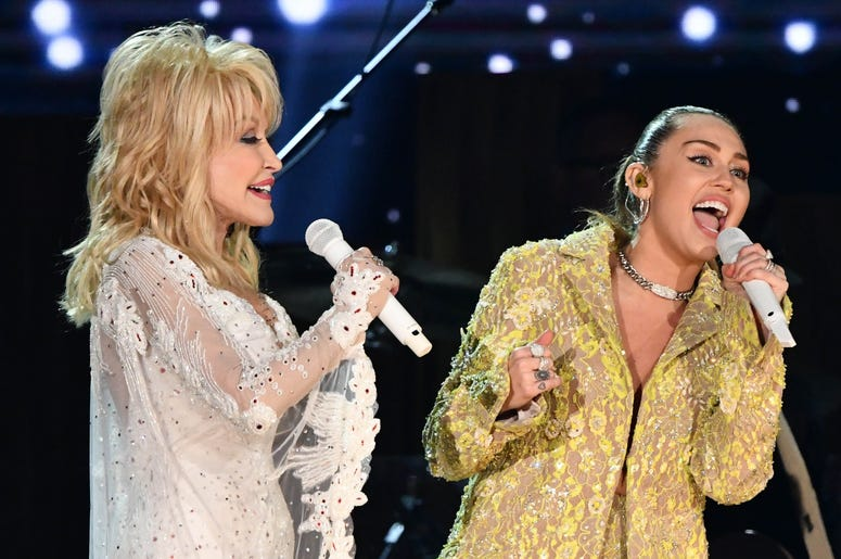 """February 10, 2019; Los Angeles, CA, USA; Dolly Parton (L) and Miley Cyrus perform \""""Jolene\"""" as part of a tribute to Dolly Parton during the 61st Annual GRAMMY Awards on Feb. 10, 2019 at STAPLES Center in Los Angeles, Calif. Mandatory Credit: Robert Hanas"""