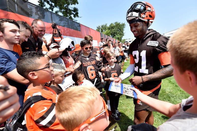 Jul 25, 2019; Berea, OH, USA; Cleveland Browns cornerback Denzel Ward (21) signs autographs after training camp at the Cleveland Browns Training Complex. Mandatory Credit: Ken Blaze-USA TODAY Sports