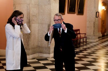 Apr 6, 2020; Columbus, OH, USA; Dr. Amy Acton (left) director of the Ohio Department of Health, and Ohio Gov. Mike DeWine (right) pose with their homemade masks following a press conference on the State of Ohio's response to the ongoing COVID-19 pandemic