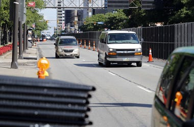 July 15, 2016; Cleveland, OH, USA; Cars pass through a corridor of security fencing assembled on the streets in preparation for the 2016 Republican National Convention held at the Quicken Loans Arena. Mandatory Credit: Andrew P. Scott-USA TODAY NETWORK