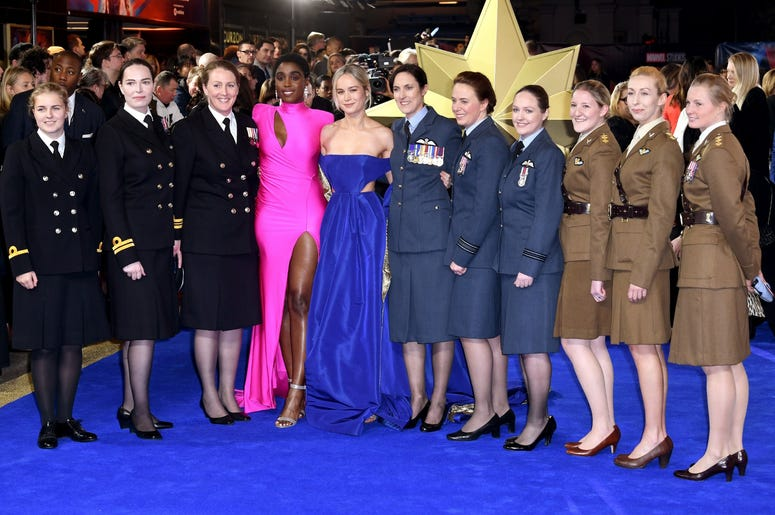 2/27/2019 - Lashana Lynch (centre left) and Brie Larson (centre right) pose with members of the UK Armed Forces at the European premiere of Captain Marvel at Curzon Mayfair, London. Picture Credit Should Read: Doug Peters/EMPICS Entertainment (Photo by PA