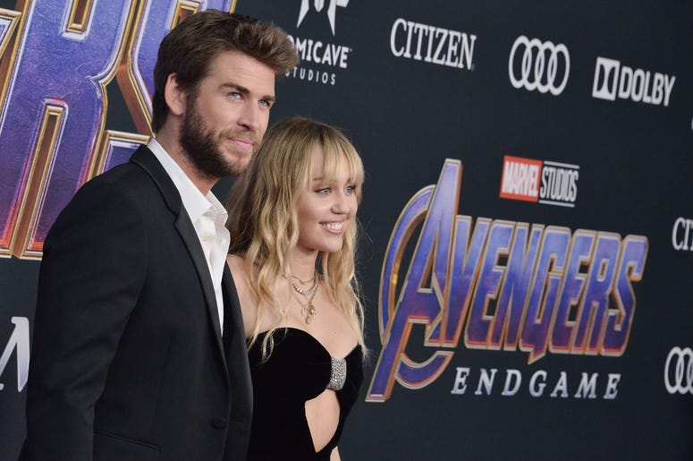 "(L-R) Liam Hemsworth and Miley Cyrus at Marvel Studios' ""Avengers: Endgame"" World Premiere held at the Los Angeles Convention Center in Los Angeles, CA on Monday, April 22, 2019. (Photo By Sthanlee B. Mirador/Sipa USA)"