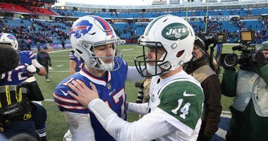 Buffalo's Josh Allen and New York's Sam Darnold greet each other after a game.