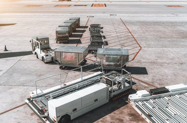 airport carts on tarmac