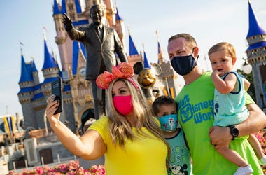 Family With Masks At Walt Disney World