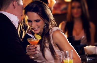 man flirting with woman at bar