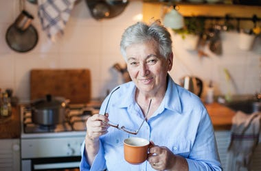 grandma in kitchen with coffee