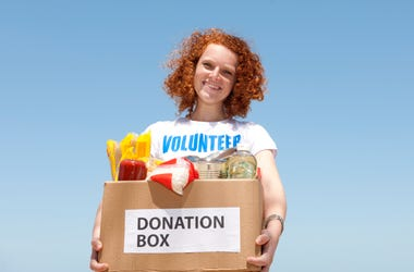 Woman Holding Donation Box