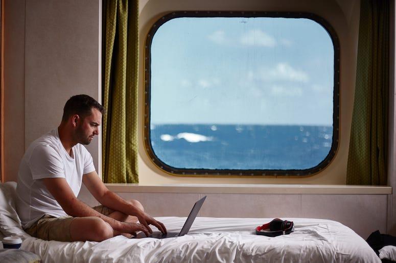 Guy On Laptop On Cruise Ship