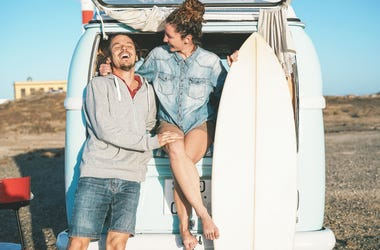 Surfing Couple Laughs