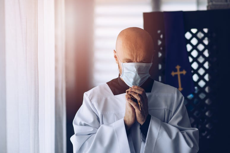 Priest with mask