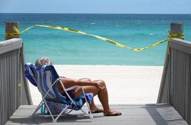 Woman On Quarantine Beach