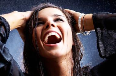 Woman Enjoying Rain