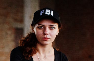 Woman Wearing FBI Hat