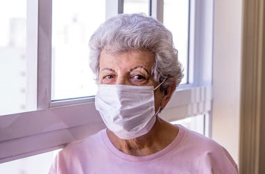 old woman wearing mask