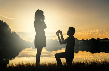 marriage proposal at sunset