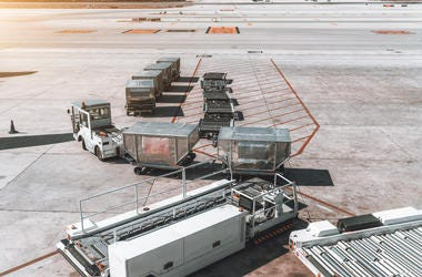 airport carts on tarmac