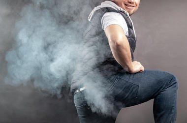 man farting with smoke