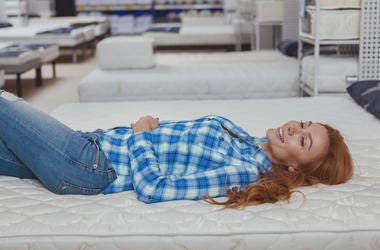 Woman in store on mattress