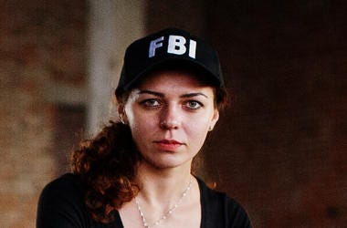 Woman Wearing FBI Hat