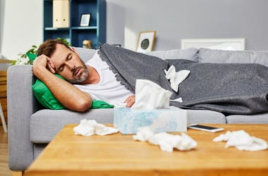 man sick on couch