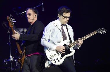 Scott Shriner and Rivers Cuomo of Weezer perform onstage during KROQ Almost Acoustic Christmas 2017