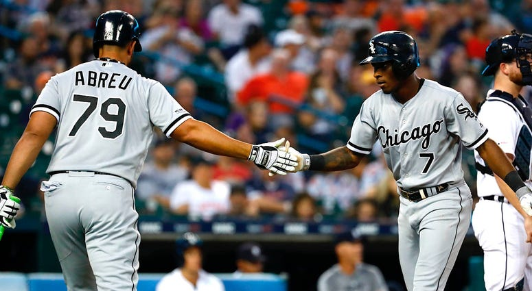White Sox shortstop Tim Anderson (7) receives congratulations from first baseman Jose Abreu (79) after homering against the Tigers.